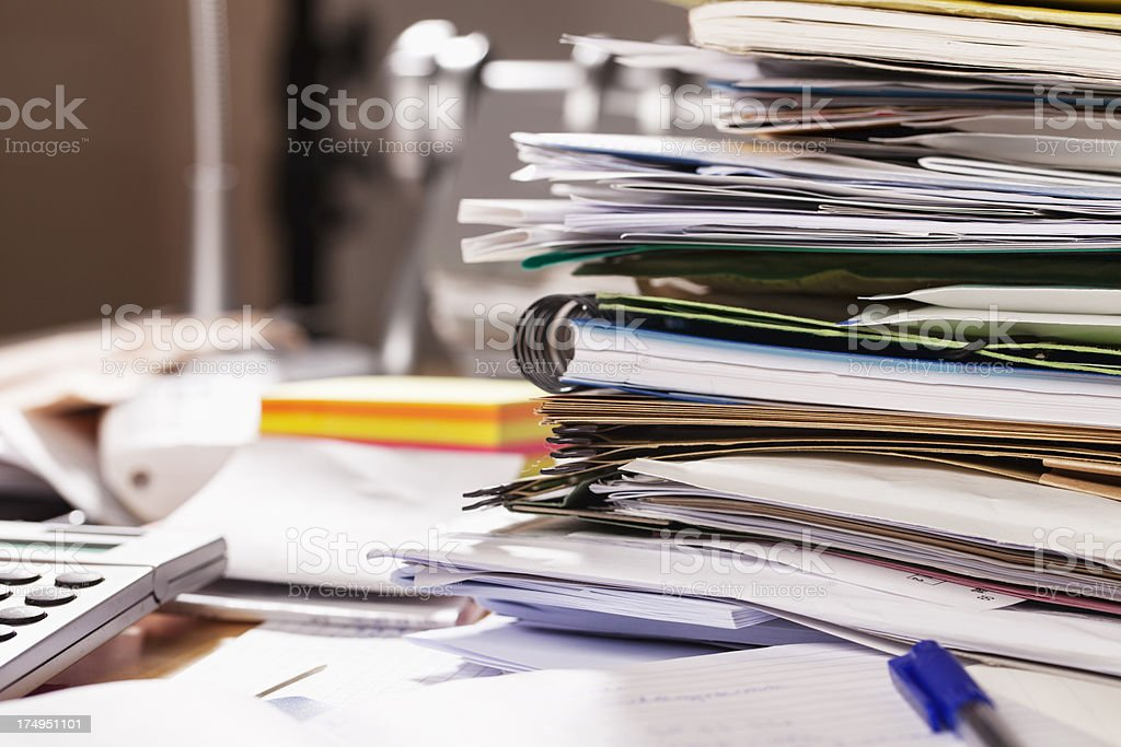 messy desktop paperwork detail stock photo