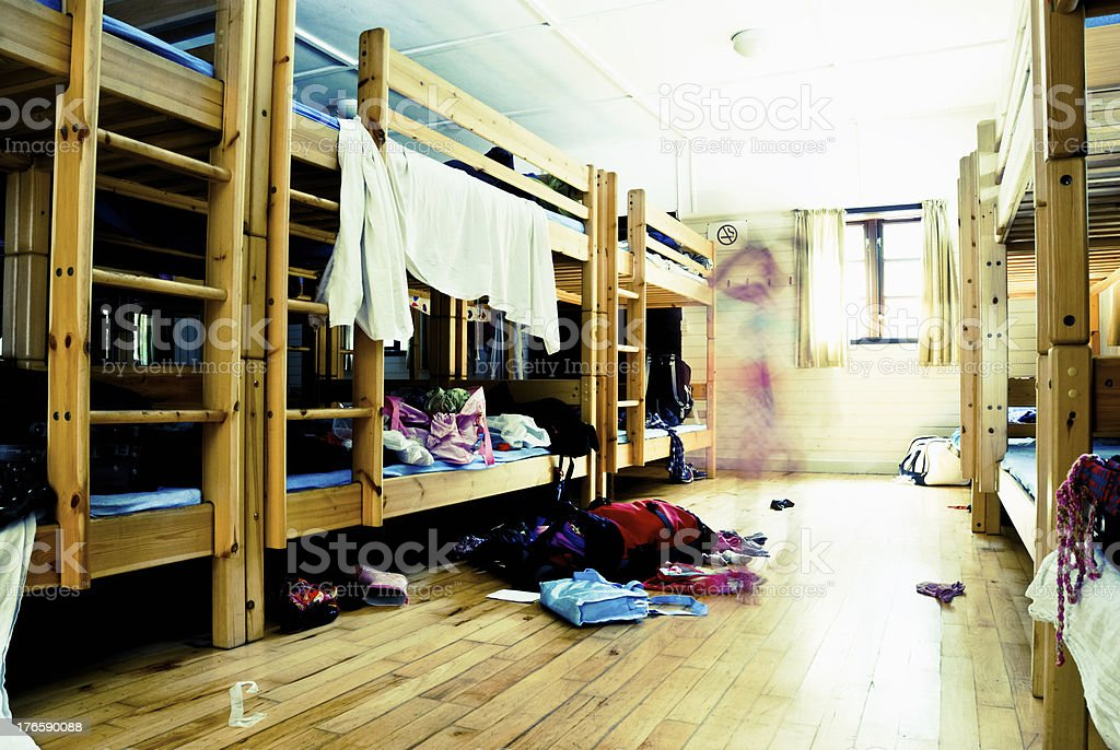 Messy dorm room with a blurred motion child stock photo