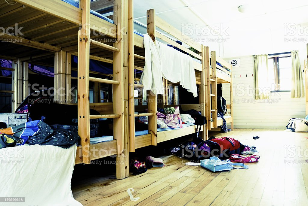 Messy dorm room with bunkbeds stock photo
