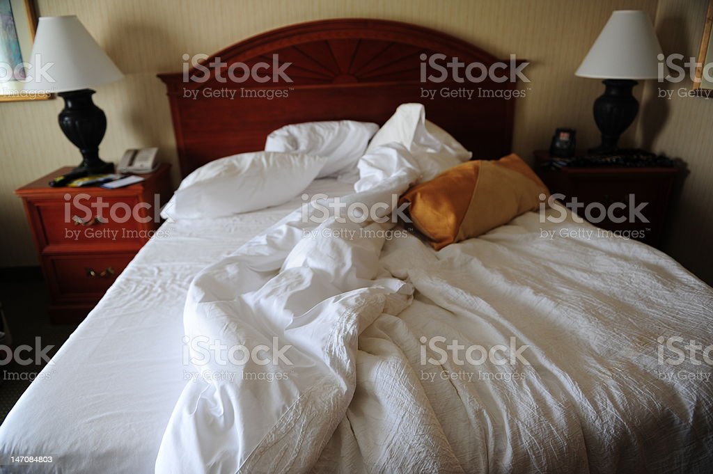 Messy hotel Bed stock photo