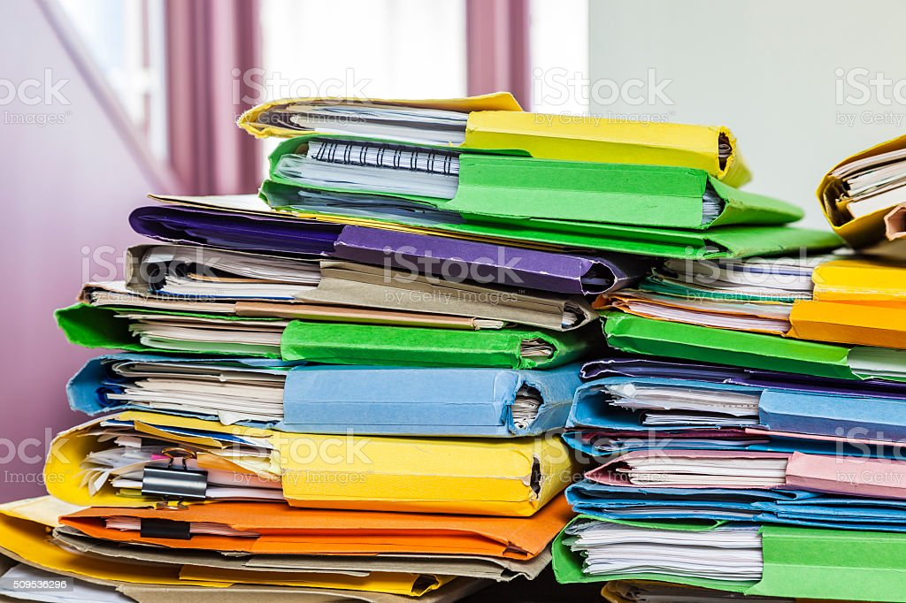Messy pile of paperwork in home office stock photo