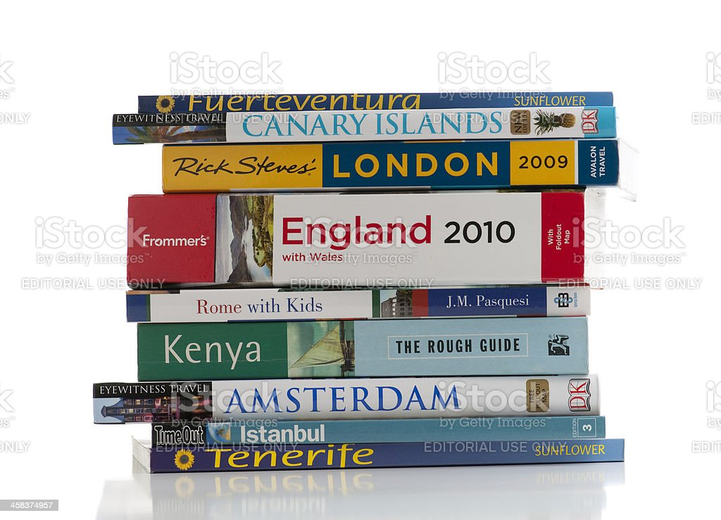 Messy pile of travel books on white background royalty-free stock photo