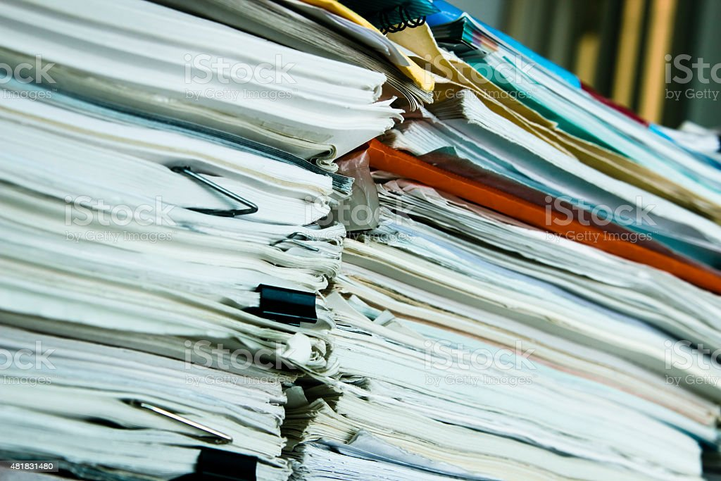 Messy piles of real paperwork stock photo