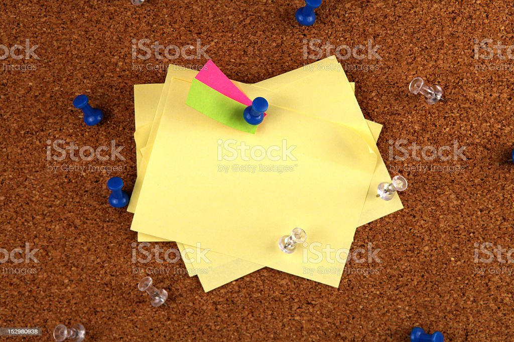 messy post it notes on cork board royalty-free stock photo