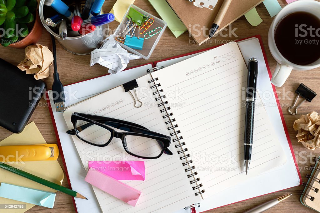 Messy Table with Blank Note and Tools stock photo