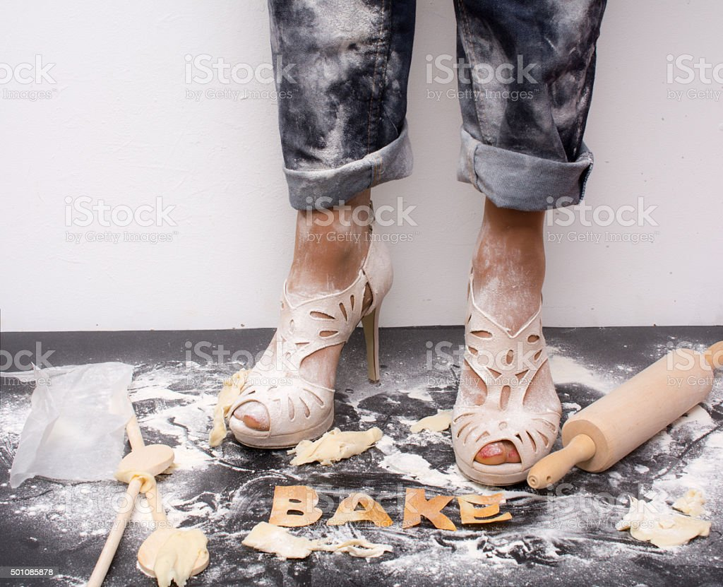 messy woman with flour heels and  word bake stock photo
