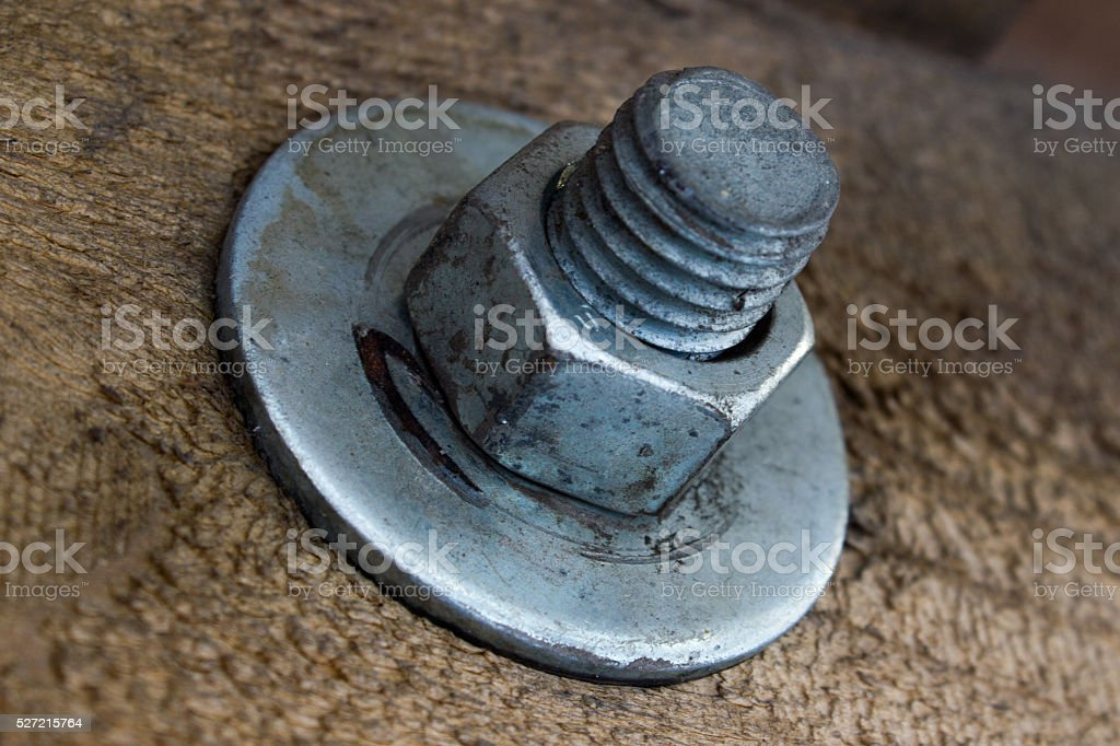 Metal anchoring wooden beams, bolt and nut stock photo