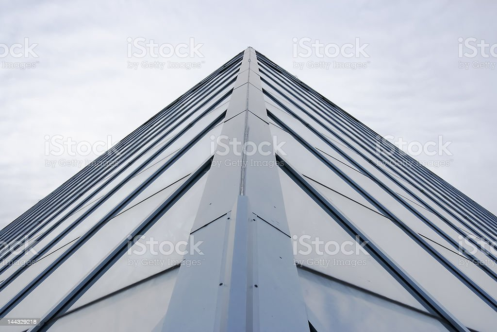 Metal and glass peak leading to sky royalty-free stock photo