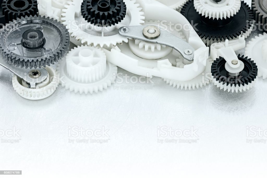 metal and plastic cogwheels and other parts of industrial machinery stock photo