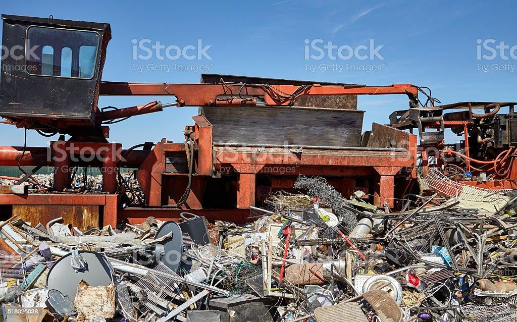 Metal and steel waste trash compacting machine stock photo