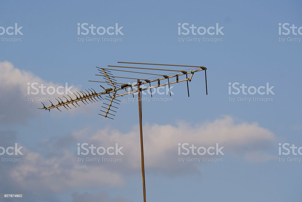 metal antenna in the sky stock photo