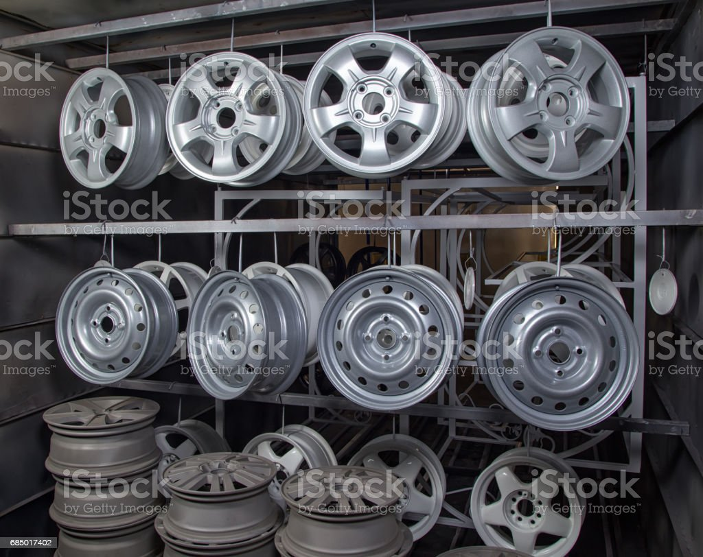 Metal auto disks drying stock photo