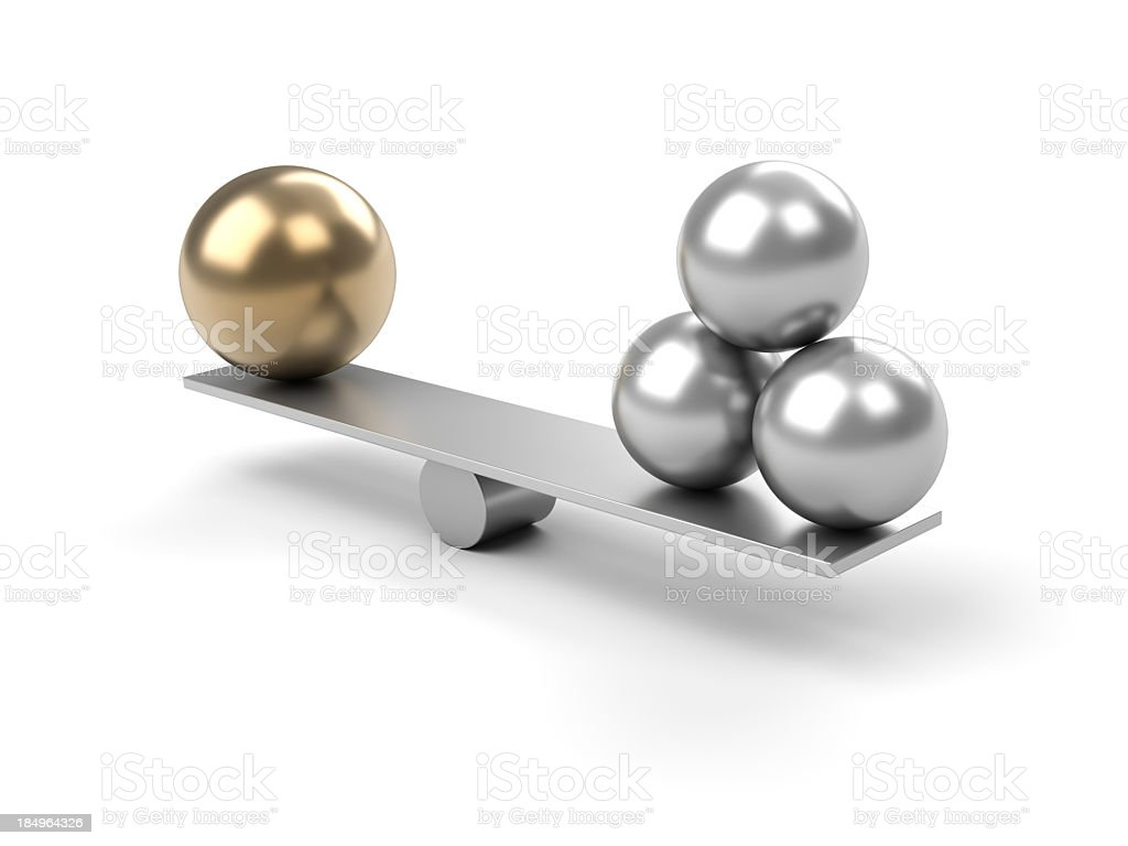 Metal balance with large ball on one side and 3 small balls stock photo