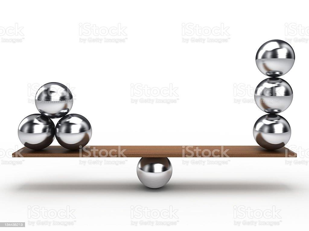 Metal balancing balls on white background stock photo