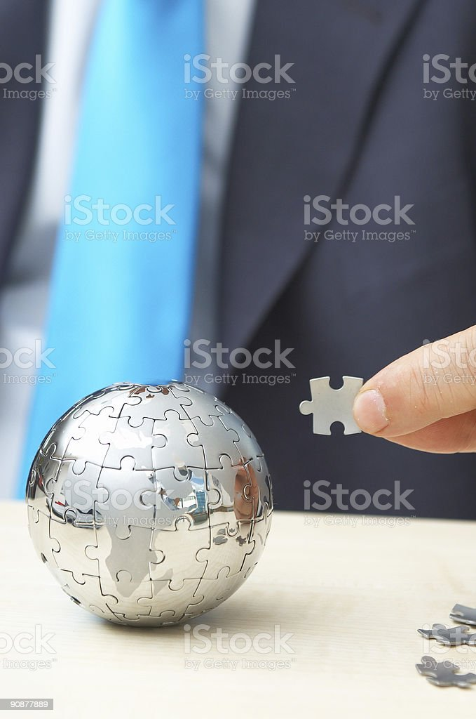 A metal ball made out of puzzles stock photo