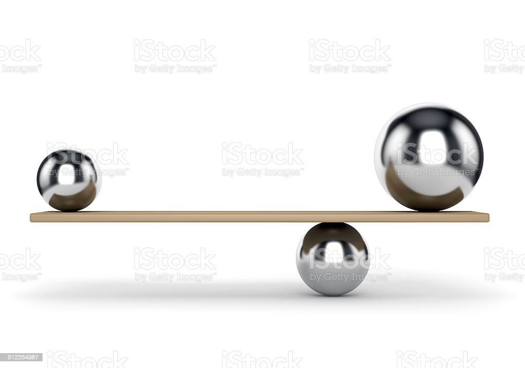 Metal balls balanced on plank stock photo