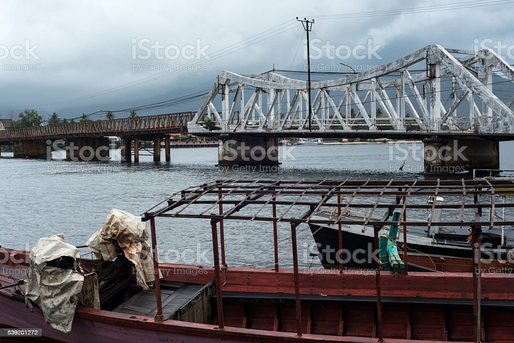 Metal bars and rust over sullen river stock photo