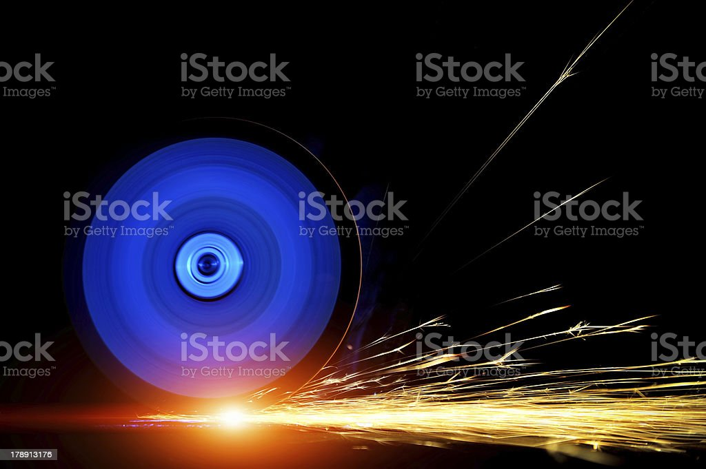 Metal being cut with the help of an electric saw stock photo
