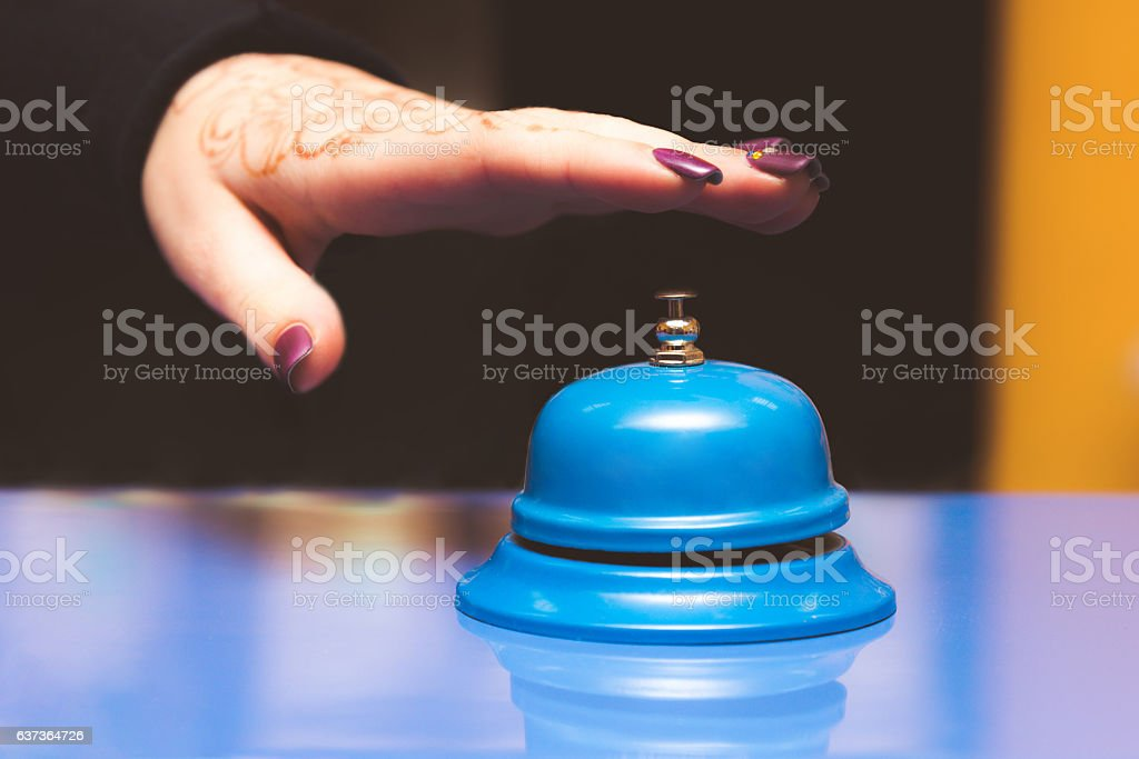metal bell blue color on the table stock photo