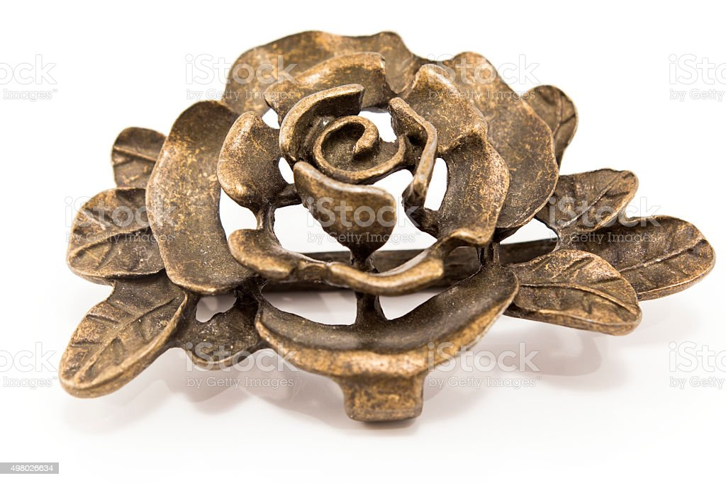 Metal belt buckle in the shape of roses stock photo