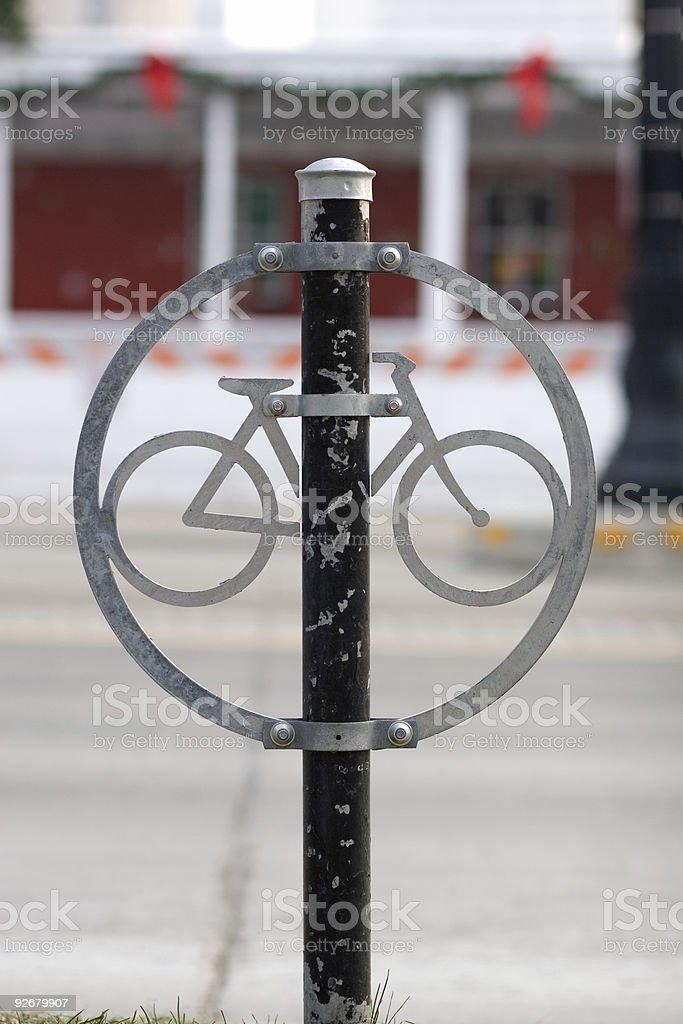 Metal Bicycle Sign on Post near City Street royalty-free stock photo