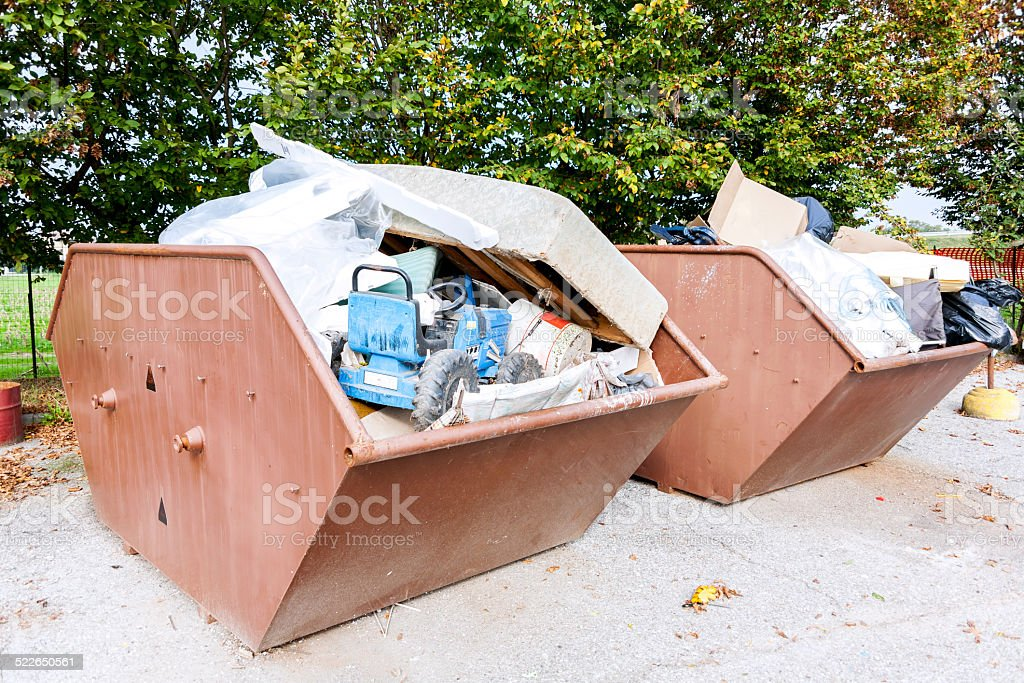 metal bins full of rubbish stock photo