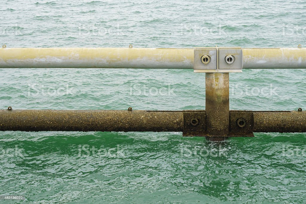 Metal block breakwater, in Singapore sea royalty-free stock photo