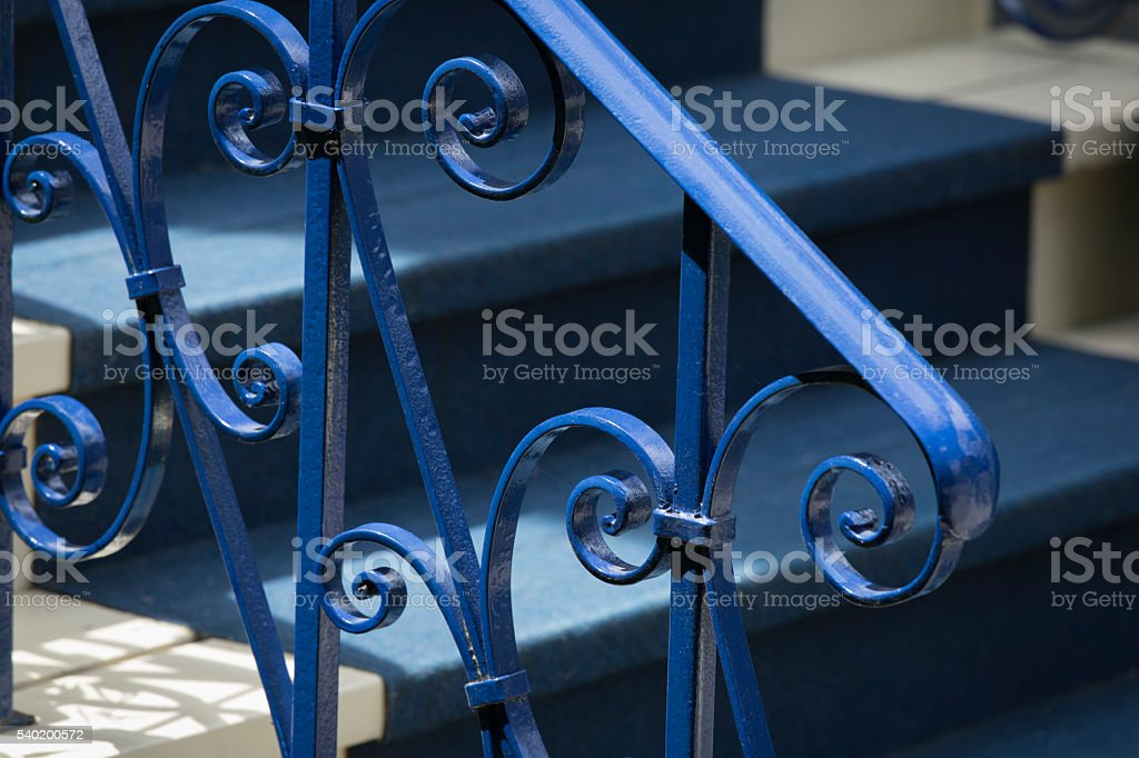 Metal Blue Banister and Blue Carpet stock photo