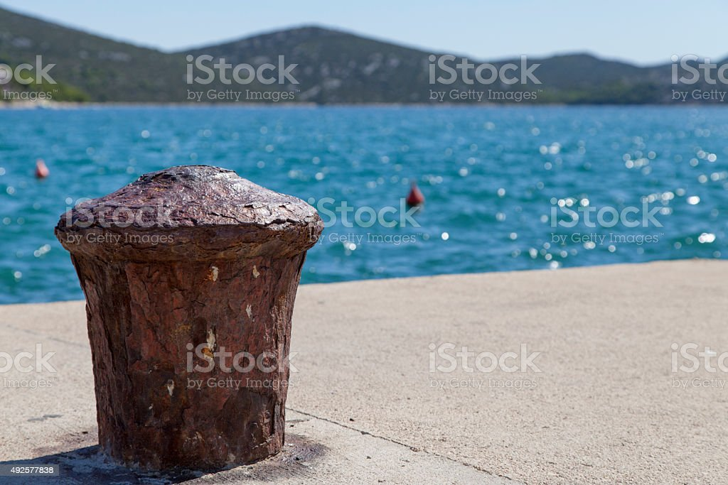 Metal bollard on the dock of pier stock photo