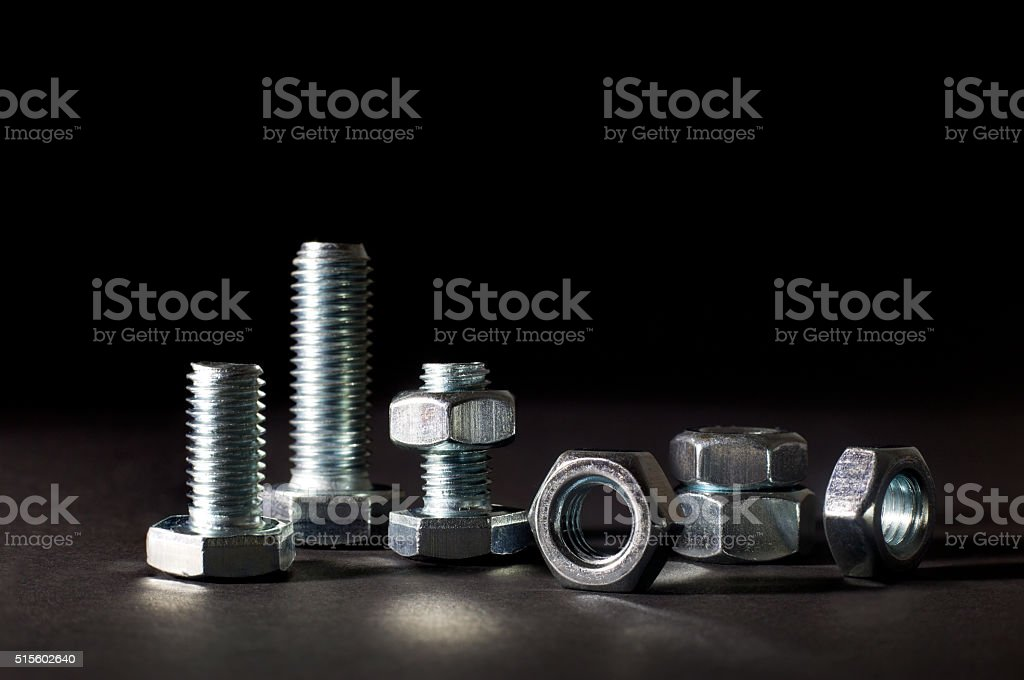 Metal Bolts And Nuts Isolated On Black Background stock photo