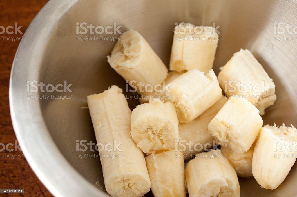 Metal Bowl of Banana Pieces stock photo