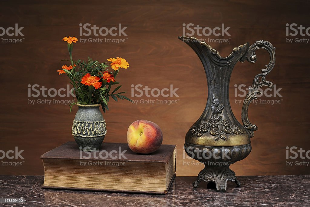 Metal bowl, peach and flowers royalty-free stock photo