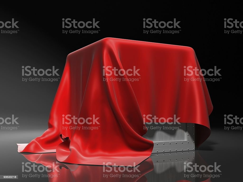 Metal box draped with red cloth, isolated on gray royalty-free stock photo