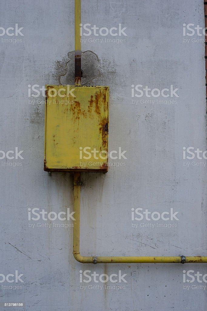 Metal box on wall stock photo
