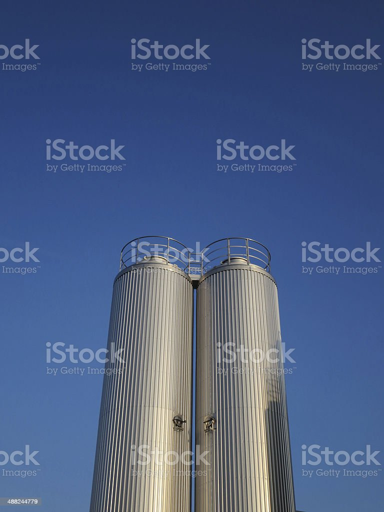 Metal Brewery Silo against Blue Sky stock photo