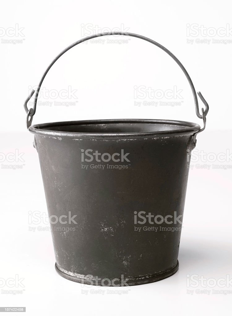 Metal bucket with an upright handle on a blank background stock photo