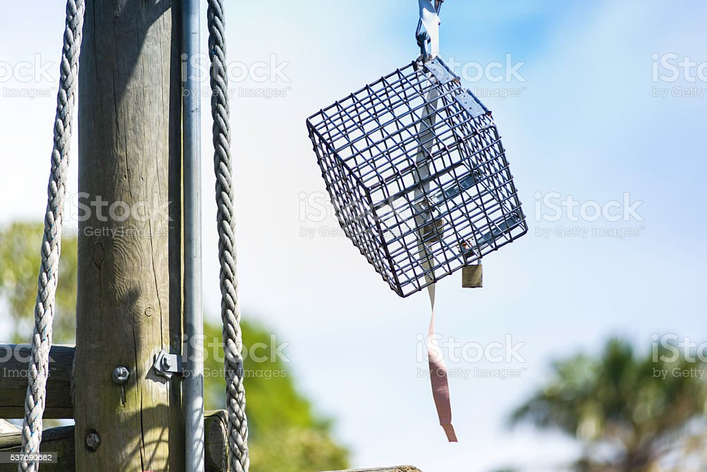 Metal cage on a rope stock photo