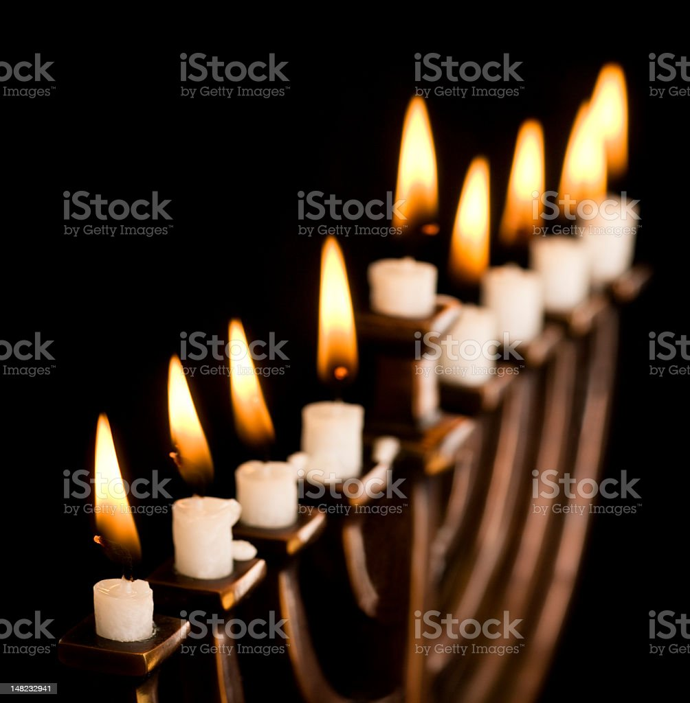 Metal candlestick with a set of candles in the dark stock photo