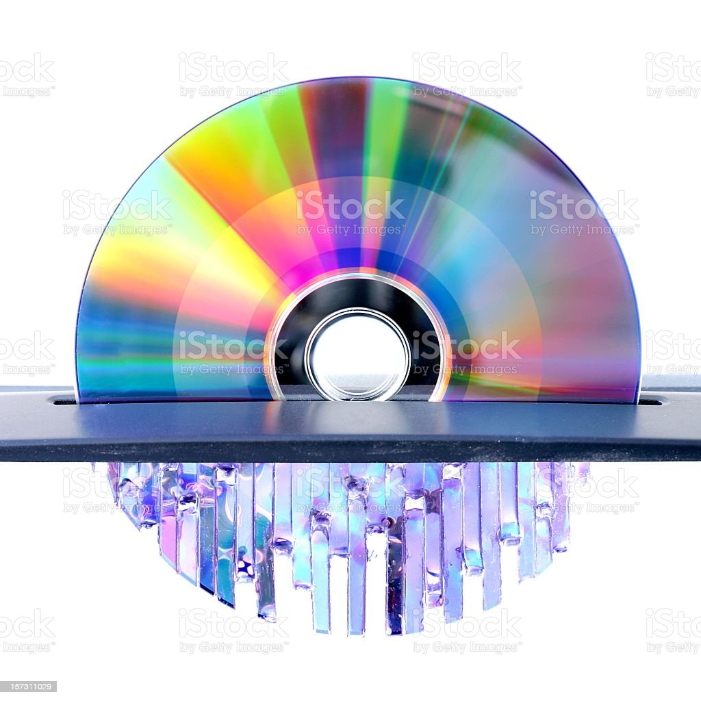 Metal cd of reflecting colors gets shredded through cutter stock photo