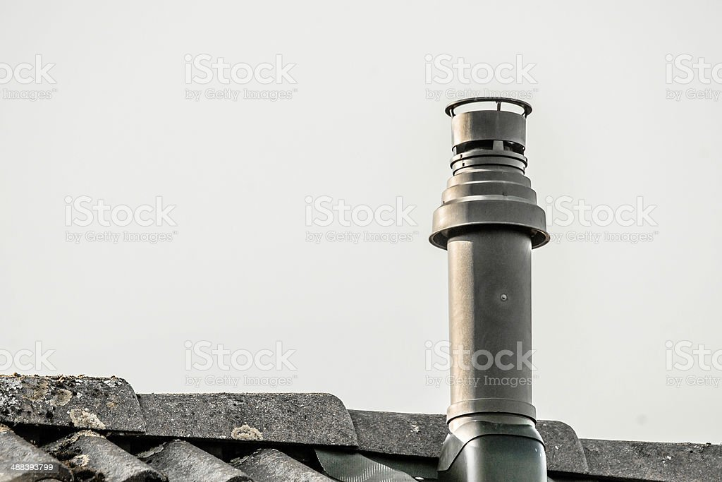 Metal chimney on the top a roof stock photo