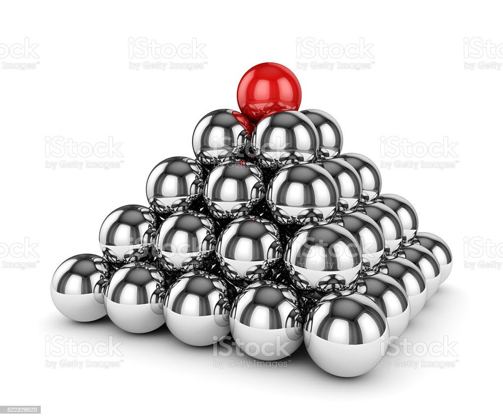 Metal chrome sphere pyramid with one red on top isolated stock photo