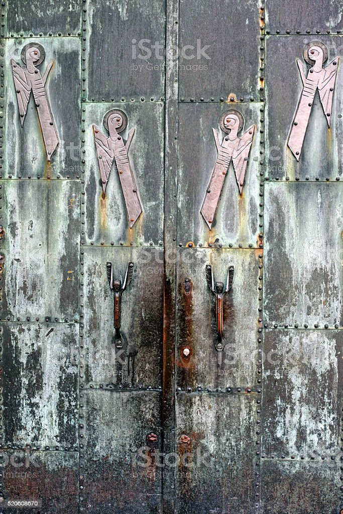 Metal church door ornate with angels royalty-free stock photo