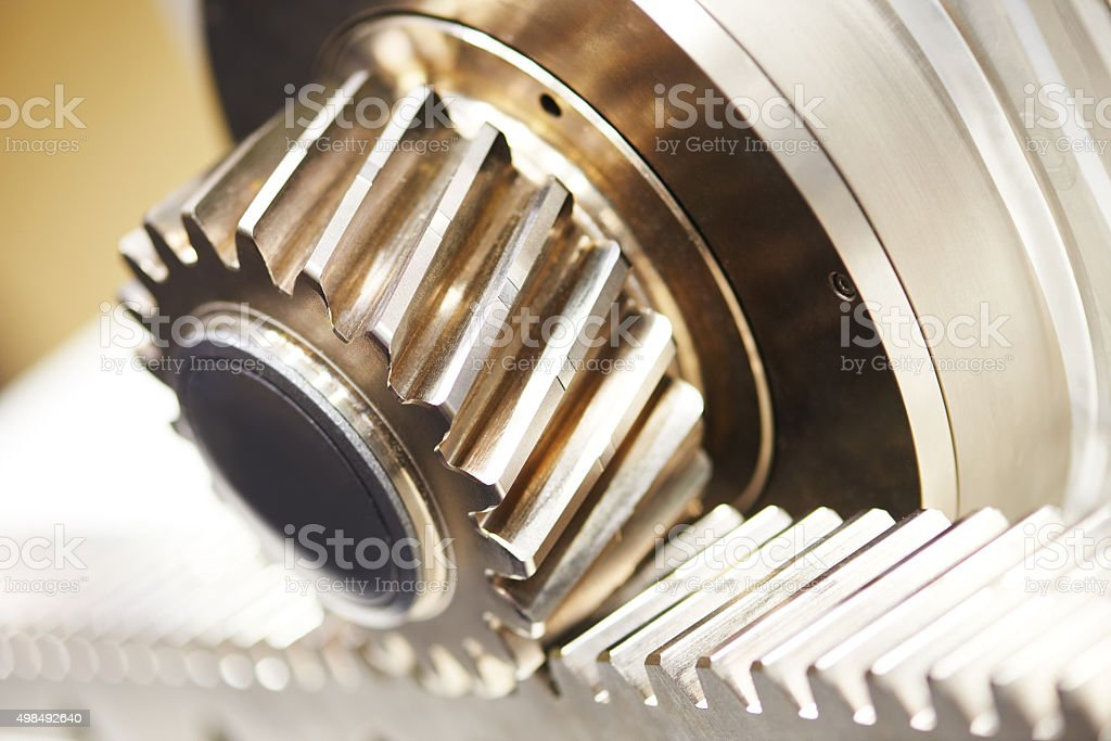 metal cog tooth wheel gear and rack stock photo
