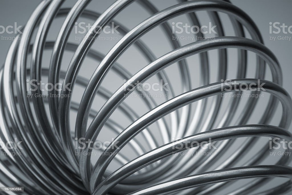 Metal coil spiraled in the form of a torus with background royalty-free stock photo