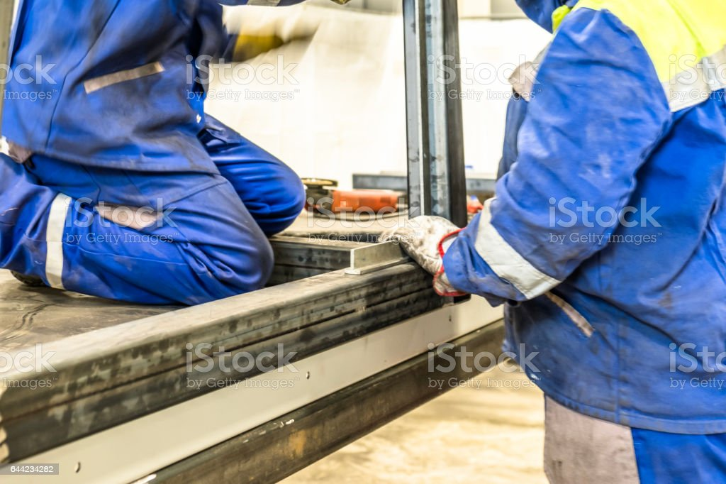 Metal construction workers with blurred motion stock photo
