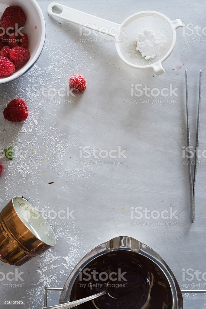 Metal countertop surface with different staff for dessert plating stock photo