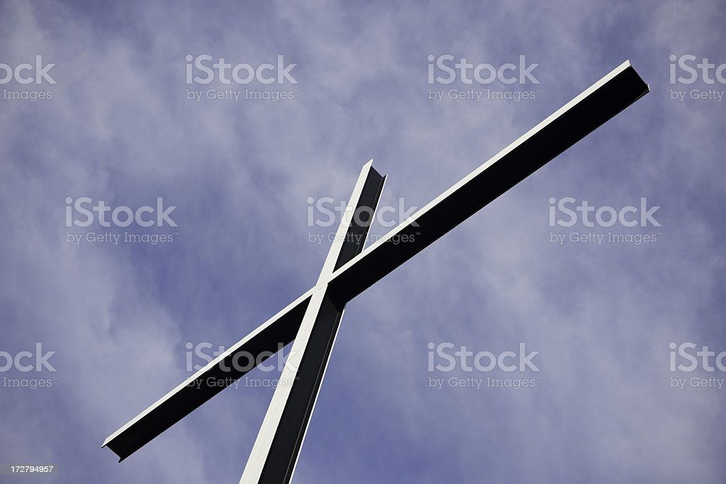 Metal Cross against Sky stock photo