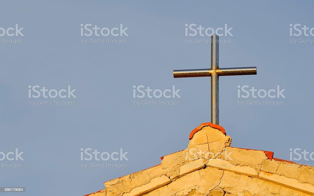 Metal cross on a chapel stock photo