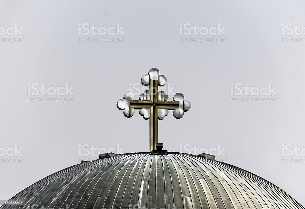 Metal cross on top of a structure royalty-free stock photo