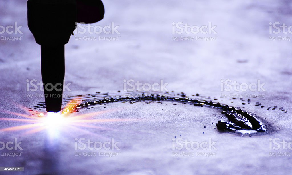 metal cutting with acetylene torch in low Light stock photo